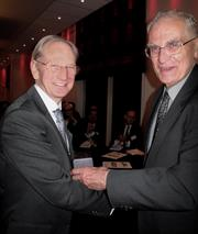 Sir David McMurtry (L) receives the Callendar Medal from Lord Oxburgh at a ceremony in October