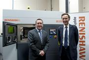 Lord Green in front of Renishaw 3D printing machine with Rhydian Pountney