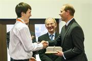 Renishaw apprentice Morgan Lloyd presents a 3D printed metal replica of Renishaw's 1802 mill building to HRH The Earl of Wessex